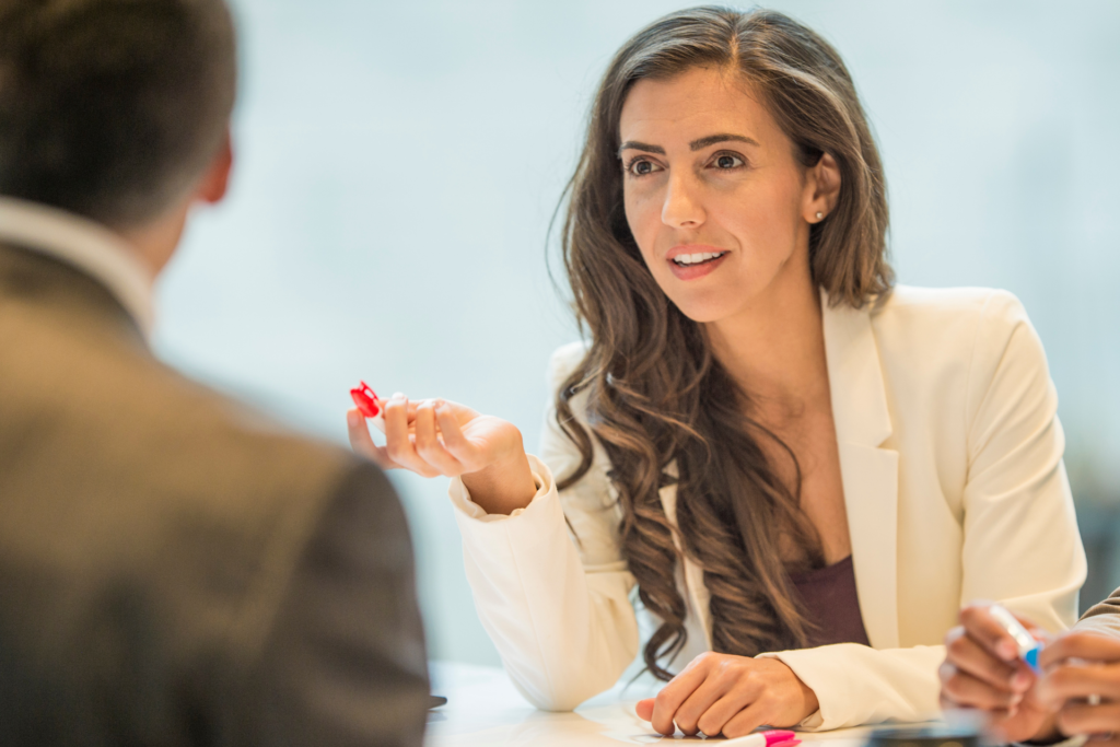 Strong woman talking during a Negotiation with a clear focus and strategy.